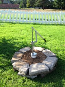 Photo of hand-pump installed in yard